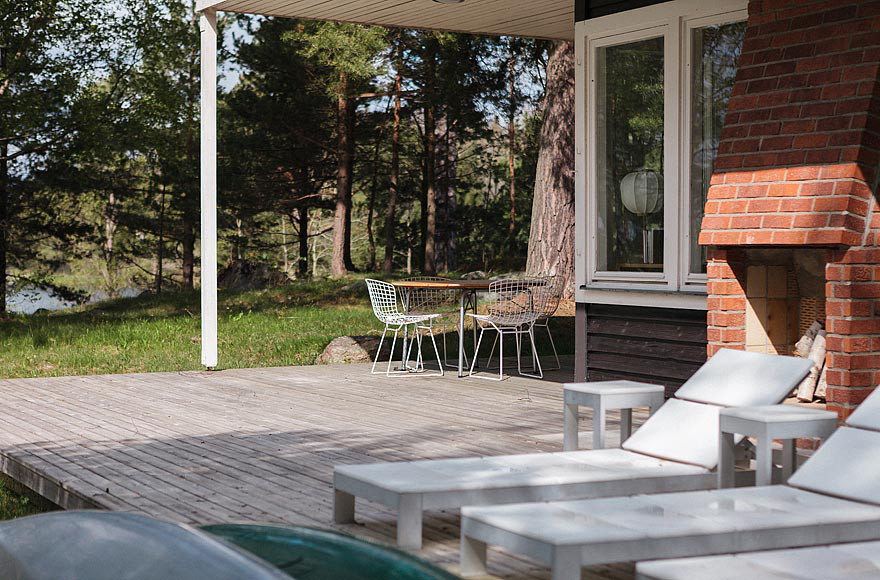 mid-century-modern-in-sweden-patio-fireplace-via-smallhousebliss