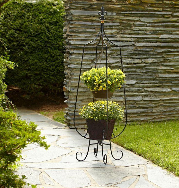 Напольная кованая подставка с оригинальными местами для цветочных горшков