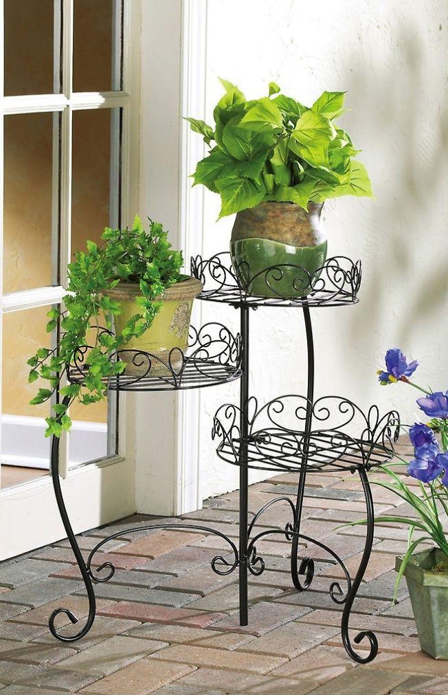 Подставка для цветов, выполненная методом ковки из прута с круглым сечением