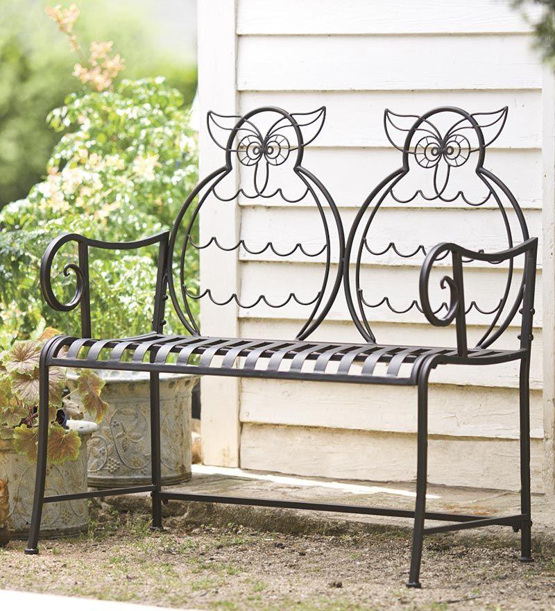 Спинка кованой скамейки выполнена в виде двух сов - креативно и необычно