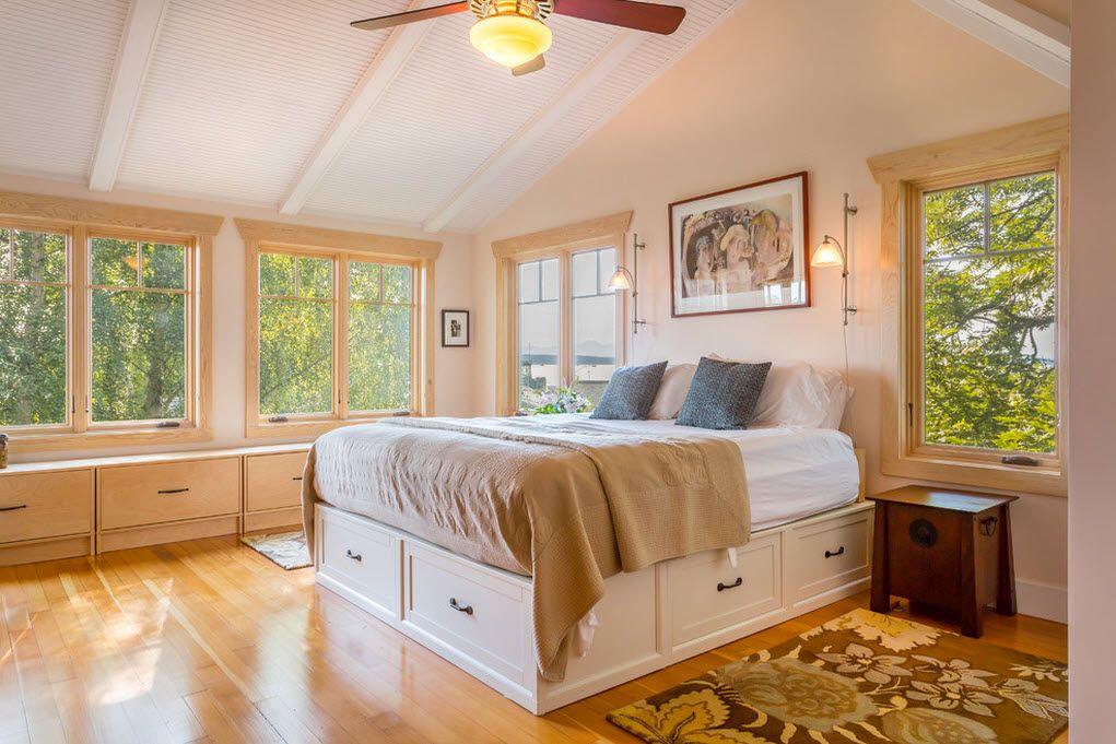 Кровать с нежным и светлым фасадом ящиков гармонично вписывается в общую картину комнаты