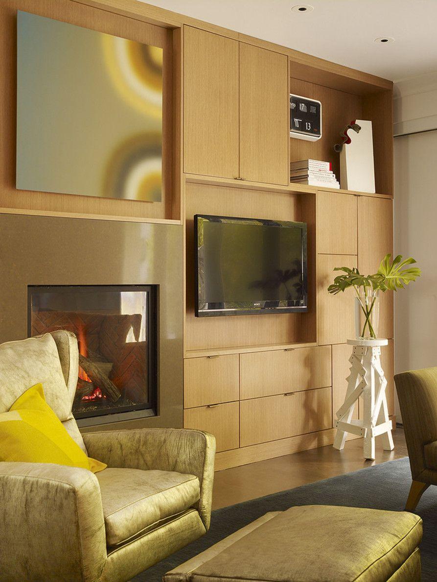 Оформление стены с камином и TV выполнено в едином стиле