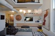 Фото 5 Телевизор на стене в интерьере (45 фото): идеи гармоничного размещения