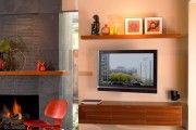 Фото 7 Телевизор на стене в интерьере (45 фото): идеи гармоничного размещения