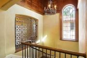 Фото 28 Кованые решетки на окна (65 фото): безопасность и декор в едином решении