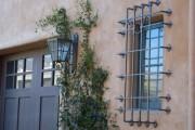 Фото 32 Кованые решетки на окна (65 фото): безопасность и декор в едином решении