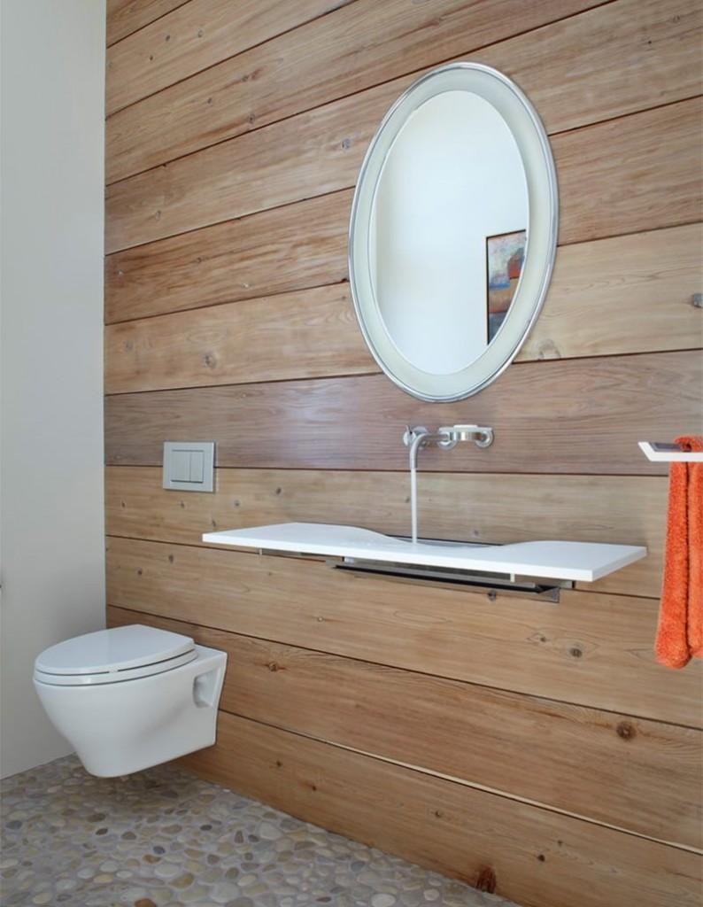 Очень тонкая подвесная раковина необычного дизайна сможет сэкономить много места в ванной комнате