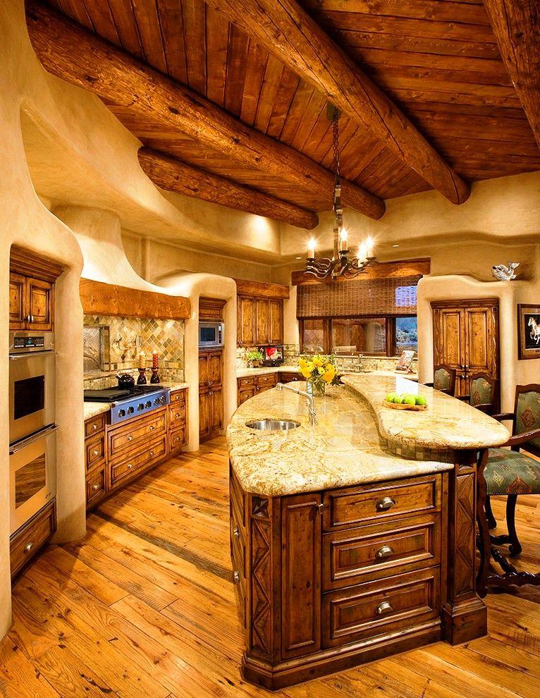 То, что это кухня, выдаёт лишь встроенная техника: здесь можно не только обедать, но и встречать гостей, работать за столом, проводить досуг