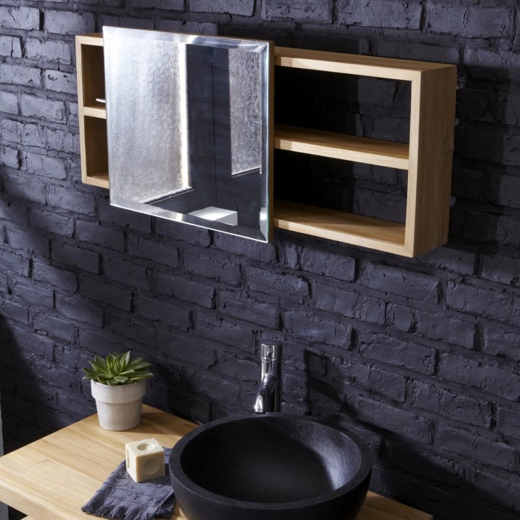 Кирпичная стена покрашенная в черный и такого же цвета матовый умывальник создают стильный дуэт