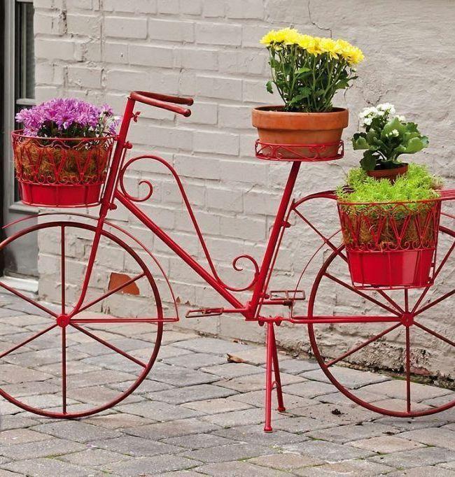 Кованая подставка для цветов стилизованная под велосипед
