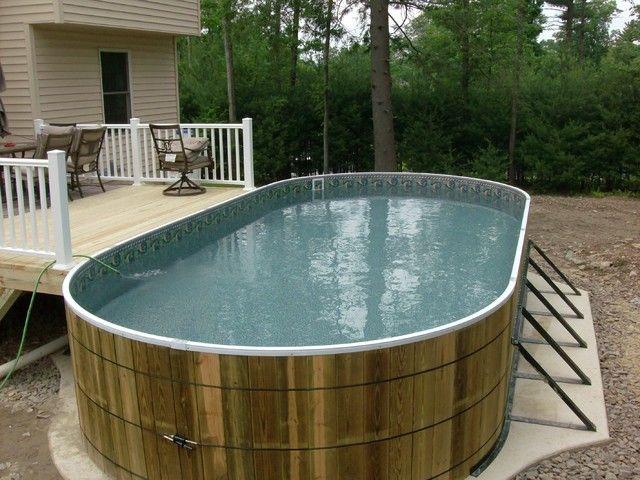 Овальный каркасный бассейн смонтирован у деревянной веранды