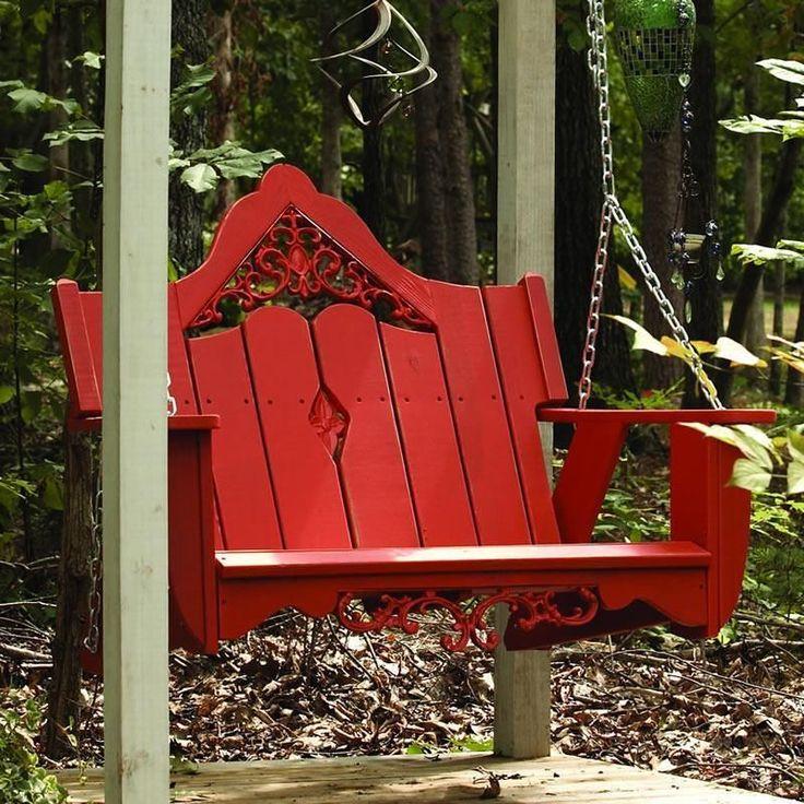Качели каркасного типа в виде красного деревянного дивана - яркий акцент для вашего участка
