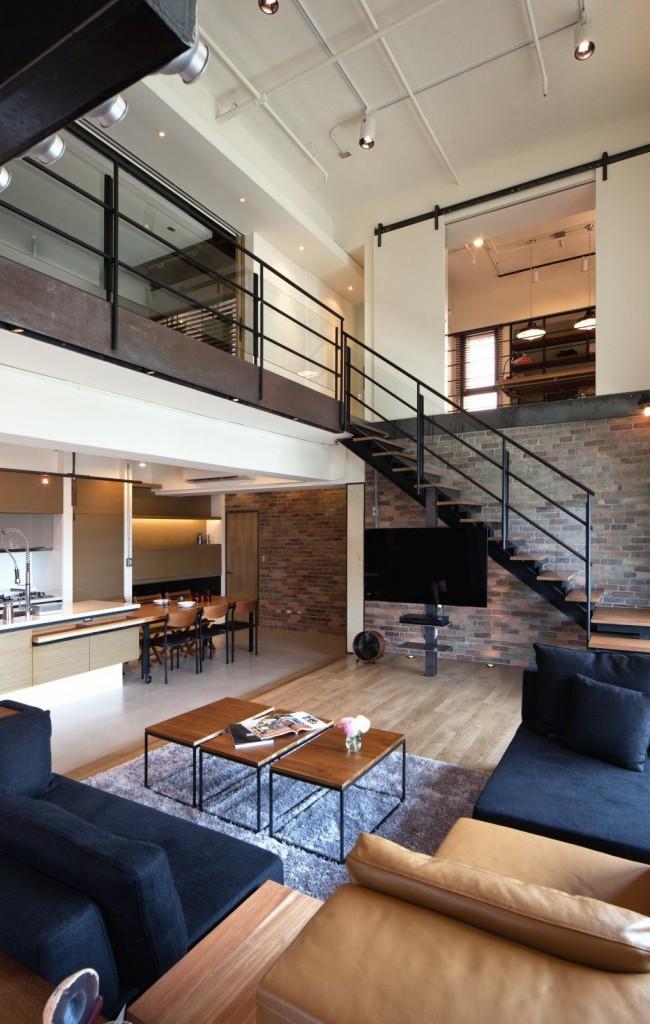 В этой квартире в одном обширном общественном пространстве объединены кухня, столовая и гостинная