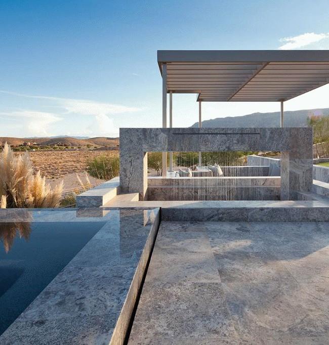Фонтан из бетона хорошо подходит для современных стилей ландшафтного дизайна