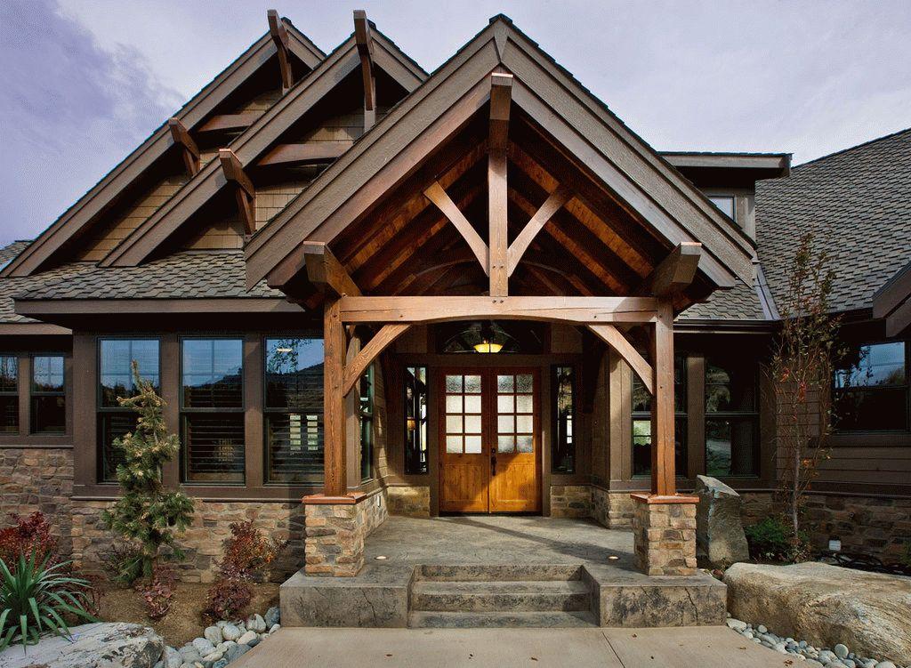 Комбинация бетона, камня и дерева в доме из бруса