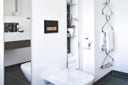 Фото 18 Полотенцесушитель для ванной: 65+ стильных вариантов для интерьера и советы дизайнеров