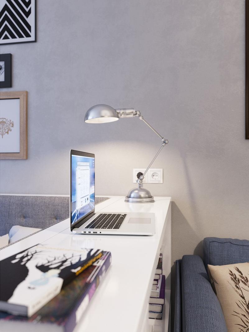 Переносная серебристая настольная лампа с округлым плафоном в современном интерьере: просто и функционально