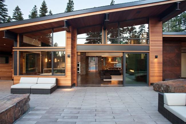 Имитация бруса лучше всего подходит для домов в современном и деревенском стиле