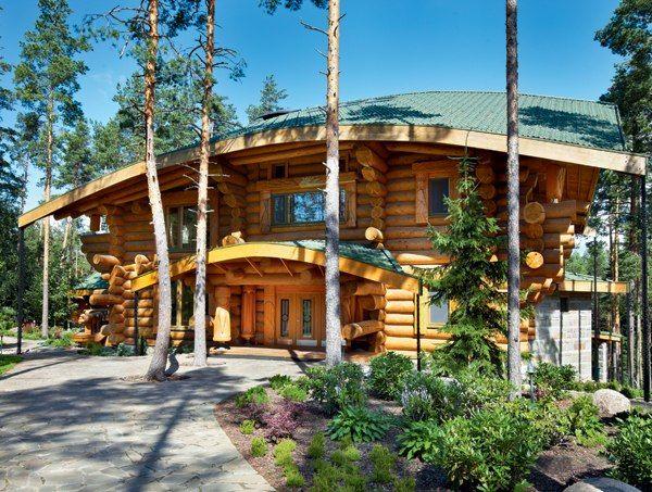 Дом из оцилиндрованного бревна с необычной и очень интересной планировкой