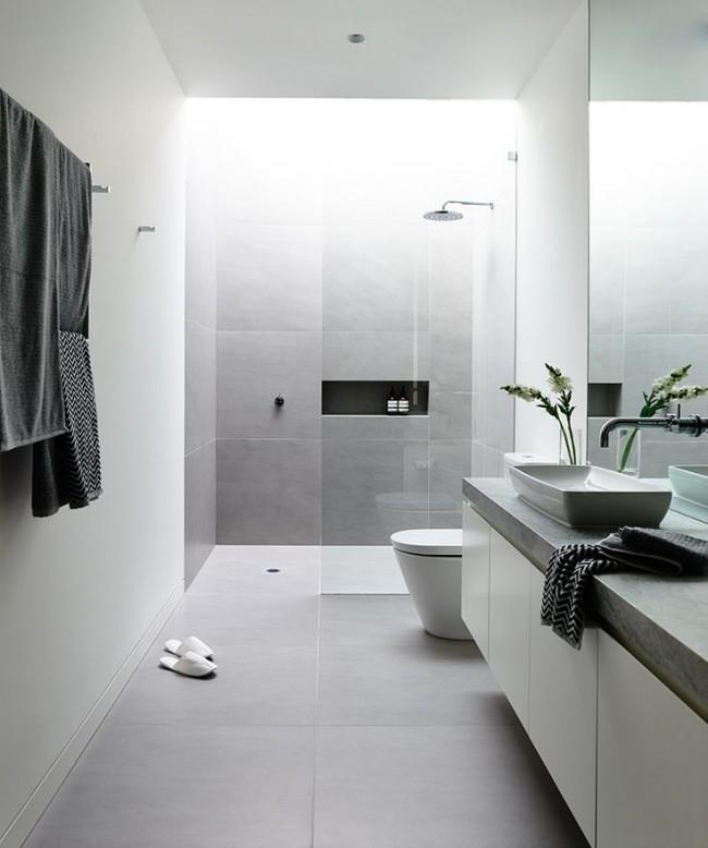 Ограждения душевой зоны без поддона - хороший способ соблюсти минималистичность обстановки либо сконцентрировать внимание на красоте материалов отделки стен