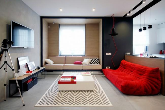 Мягкая мебель для зала. Одиночный ярко-красный акцент на черно-белом фоне всегда смотрится интересно. Таким акцентом может выступить диван медиа-зоны