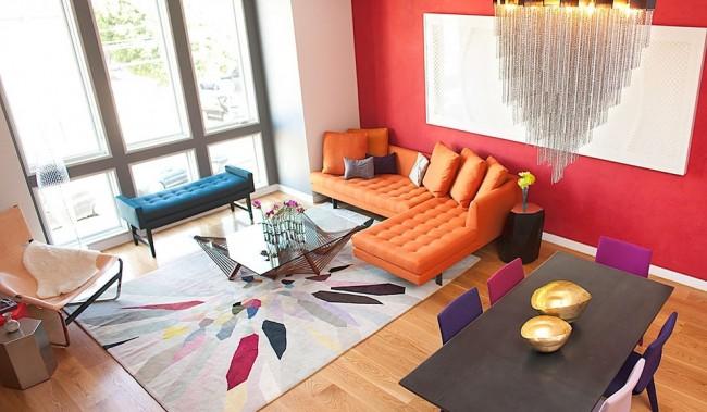 Ковры в интерьере гостиной. Для яркого интерьера в современном стиле лучше подбирать фабричные ковры из искусственных материалов - они дольше остальных сохраняют форму