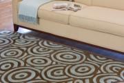 Фото 9 Ковры в интерьере гостиной (57 фото): современный подход к выбору ковровых изделий