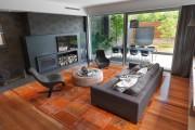 Фото 16 Ковры в интерьере гостиной (57 фото): современный подход к выбору ковровых изделий