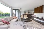 Фото 18 Ковры в интерьере гостиной (57 фото): современный подход к выбору ковровых изделий
