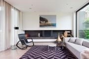 Фото 6 Ковры в интерьере гостиной (57 фото): современный подход к выбору ковровых изделий
