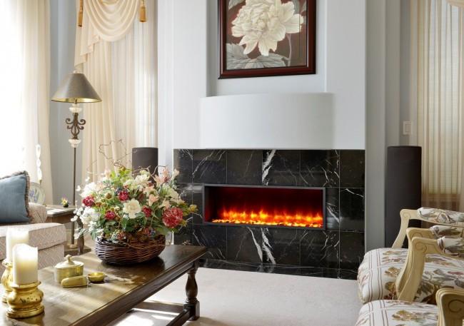 Электрический камин легко может стать центром любого помещения, в котором он находится.