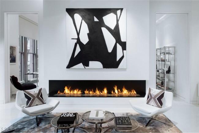 Электрический камин несет эстетическую и практическую функцию, дополняя пространство уютом и теплом.