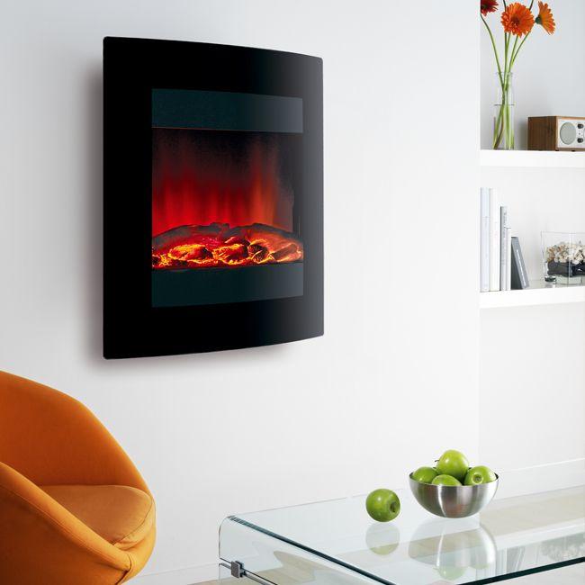 Электрический камин в интерьере умеет не только имитировать пламя, но даже создавать иллюзию тлеющих углей