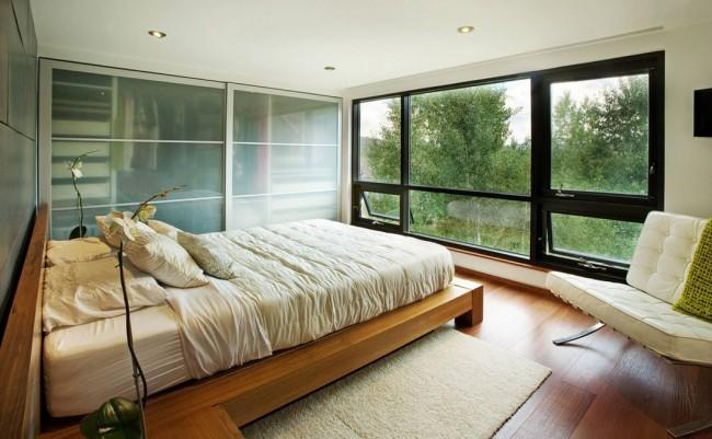 Мебель в спальне стиля модерн имеет более изящные очертания