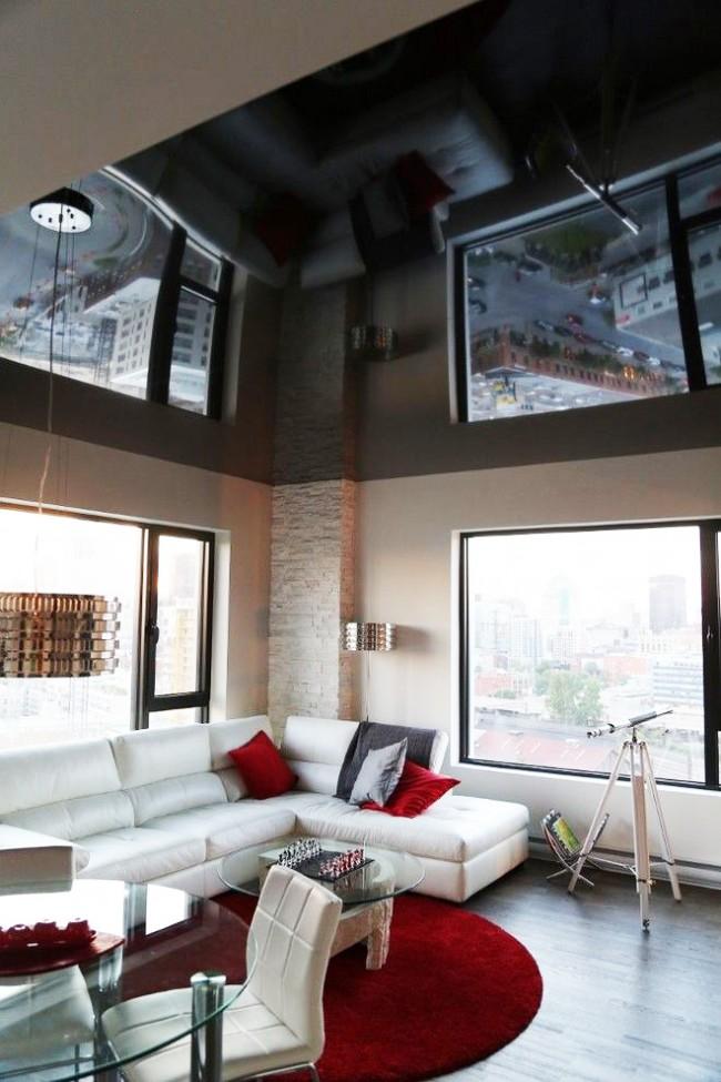 Гостиная с черным натяжным потолком будет выглядеть необычно, респектабельно и стильно