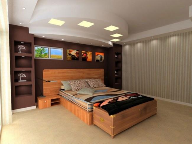 Многоуровневый потолок с разными светильниками - эффектное решение для спальни