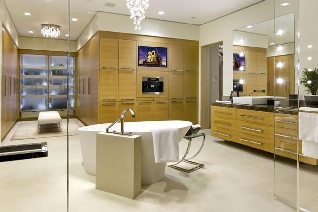 Влагозащищенные светильники для ванной комнаты. Встроенные одинарные светильники выглядят нейтрально, поэтому ими можно в любом количестве дополнять верхний свет от подвесных декоративных светильников