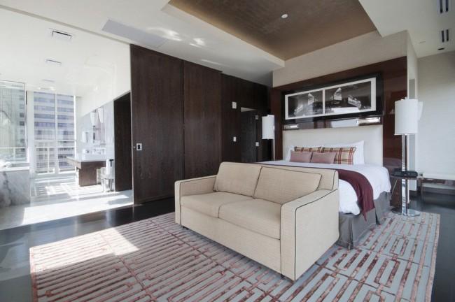 Межкомнатная дверь из шпона темного цвета прекрасно сочетается с дизайном спальни в современном стиле