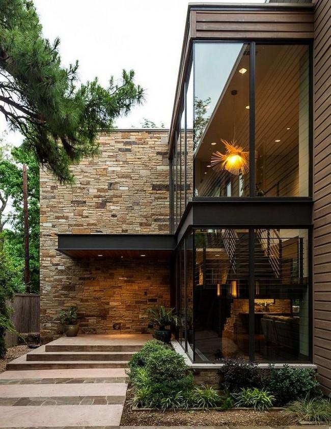 Шикарный загородный дом в стиле модерн с виниловым сайдингом под камень