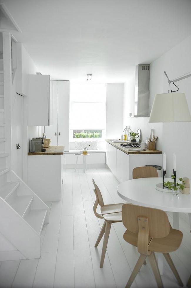 Белая кухня - визитная карточка современного минималистичного стиля интерьера