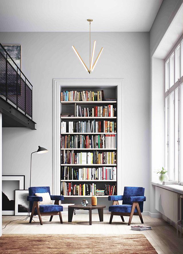 Обширная библиотека в интерьере гостиной