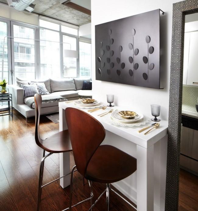 Если места в квартире очень мало, небольшую барную стойку иногда располагают непосредственно у стены