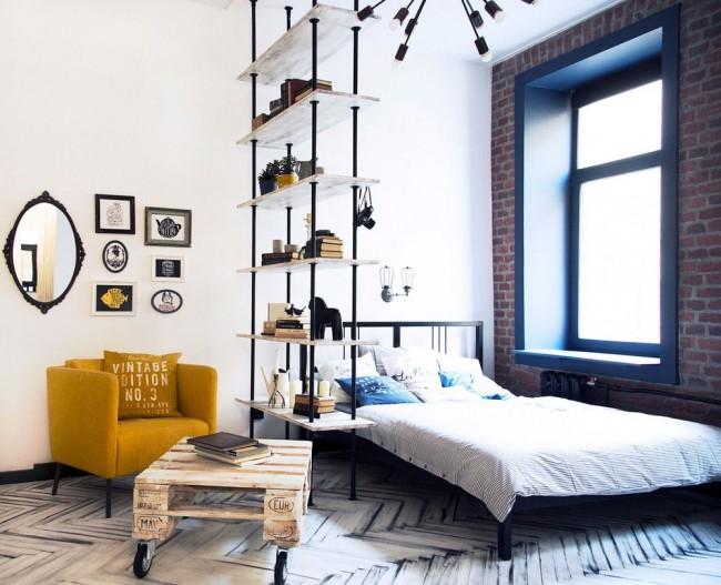 Интерьер гостиной, совмещенный со спальней, в стиле лофт