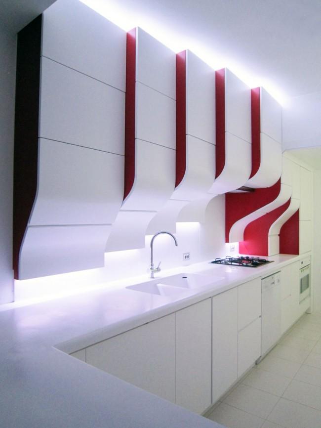 Необычные очертания, формы и яркое красно-белое сочетание создает интерьер, похожий на дом будущего