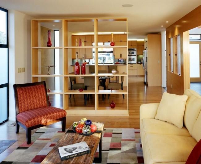 Стеллаж может выступать как место хранения, как предмет декора, и для организации пространства