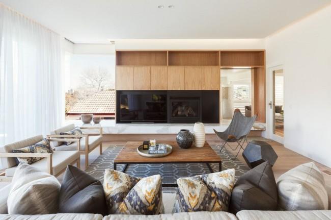 Стенка в гостиной с местом под телевизор и декоративный камин