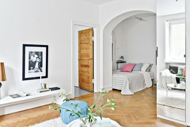 Гостиная и спальня в одной комнате. Ниша с аркой из гипсокартона для обустройства спальни