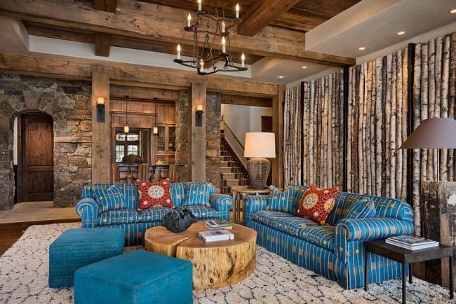 Деревянные балки на фоне каменных стен в гостиной стиля рустика