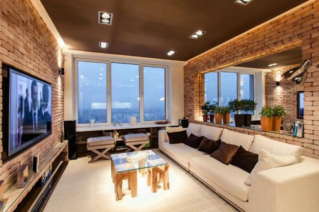 Если грамотно составить дизайнерский проект, то кирпичную стену можно вписать и в современную гостиную с плазменной панелью и другими технологичными решениями