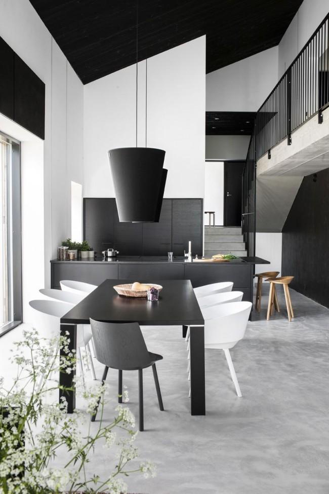 Черный пластиковый стол в кухне стиля хай-тек